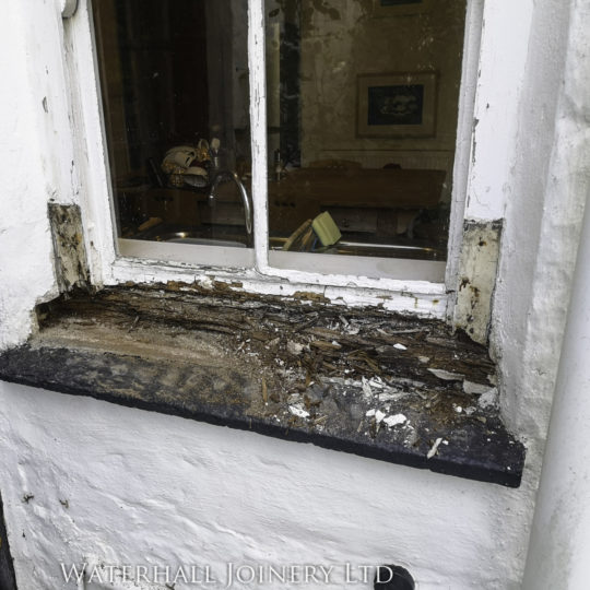 Old rotten window frame in need of repair