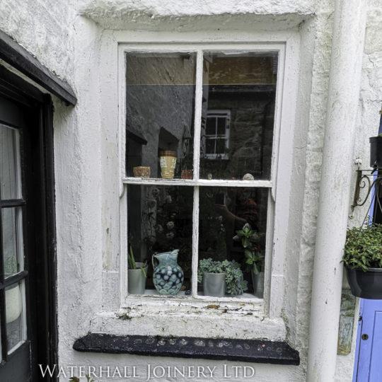 Sash window in need of repair