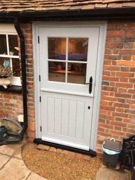 Single Glazed Cottage Stable door with antique black door furniture. Bespoke Joinery
